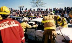 Rescue and ambulance personnel operate at the 1998 mock crash at AGHS