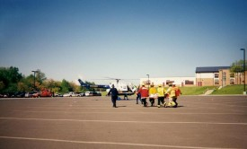 Carrying the victim to Skycare, AGHS Mock Crash in 1998