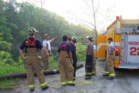 Firefighter Dave Talley explains the fine points of drafting