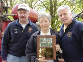 Chief John  Chambers and President Bill Wohl present Elsie Thorpe with a commemorative plaque honoring the return of Antique 22 to the West Grove Fire Company.  Mrs. Thorpe's husband was the owner of the 1927 Hale Pumper.  She contacted the WGFC upon her husband's death, allowing Antique 22 to return to her orginal home after more than 50 years.
