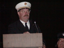 Fire Chief John Chambers addresses the crowd gathered for the 100th Anniversary & Housing