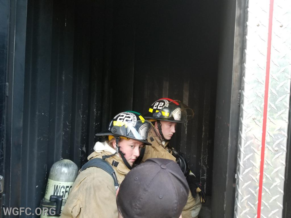 Firefighter Ally Colgan and junior member Tucker Aliberti getting last minute instructions before heading in