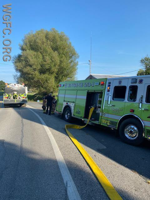 Avondale Engine 23-1 and Tanker 23 at the water supply location south of the fire scene.