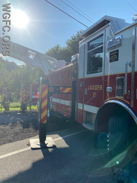 Union Fire Company's Ladder 21 properly positioned to extend its aerial ladder to the roof, while avoiding power lines at the edge of the roadway.