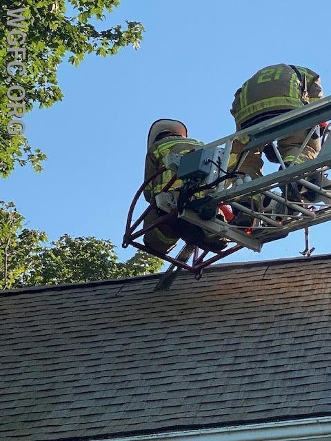 Oxford's crew on Ladder 21 cut a second ventilation hole to relieve high heat and smoke from the third floor bedroom and attic storage area.