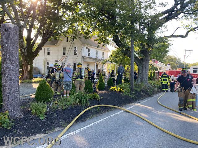 This view shows the third floor bedroom windows, and the manpower pool at this late afternoon house fire in Franklin Township.