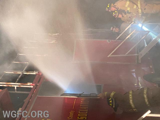 Here a fog nozzle is used to eject smoke from a fire room -- a proven method of mechanical ventilation.