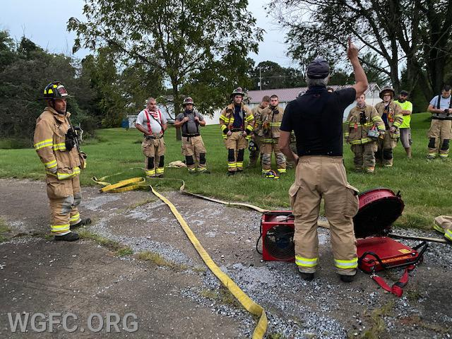 WGFC members get familiar with ventilation methods at training night in New London.   Here the firefighters review positive pressure and exhaust fans.