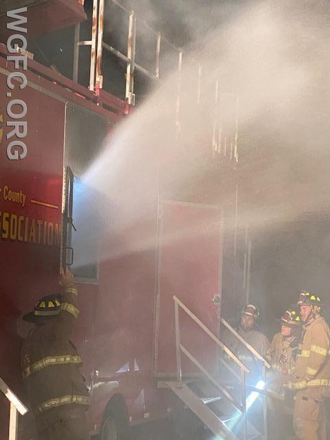 Venting smoke is rehearsed in the burn trailer at the WGFC's New London Station.