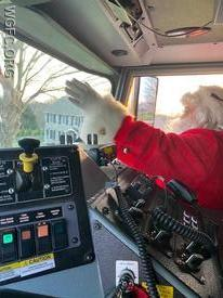 Santa waves goodbye as he returns to the North Pole after riding the engines of the West Grove Fire Company.