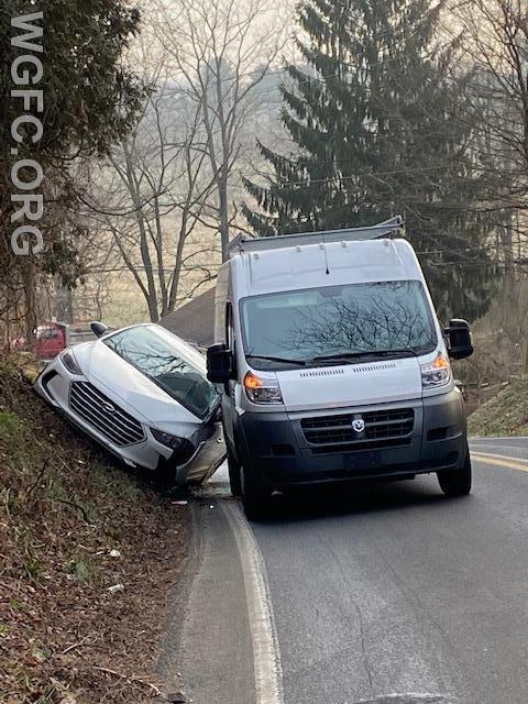 This van and car collided on the steep hill on Garden Station Road in London Grove Township.