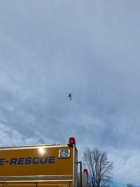The helicopter of the PA State Police passes over Engine 22-1 Saturday afternoon.