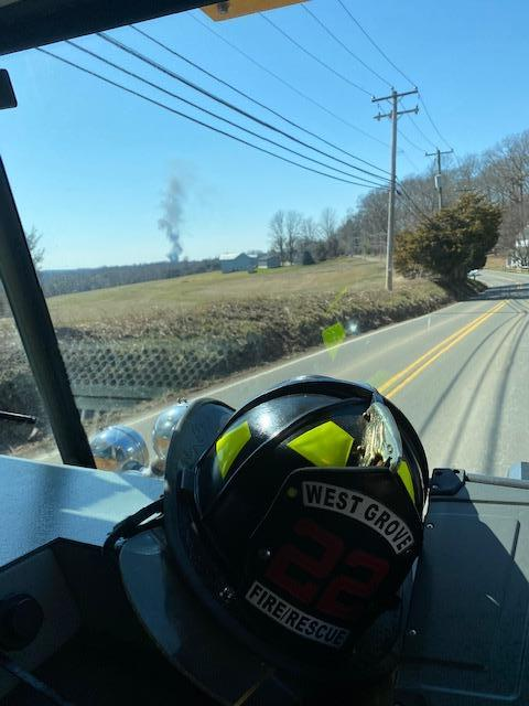 """Smoke showing in the distance in this shot from the officer's seat in Rescue 22 taken along Oxford Road.  In the firefighting business, this is called a """"header."""""""