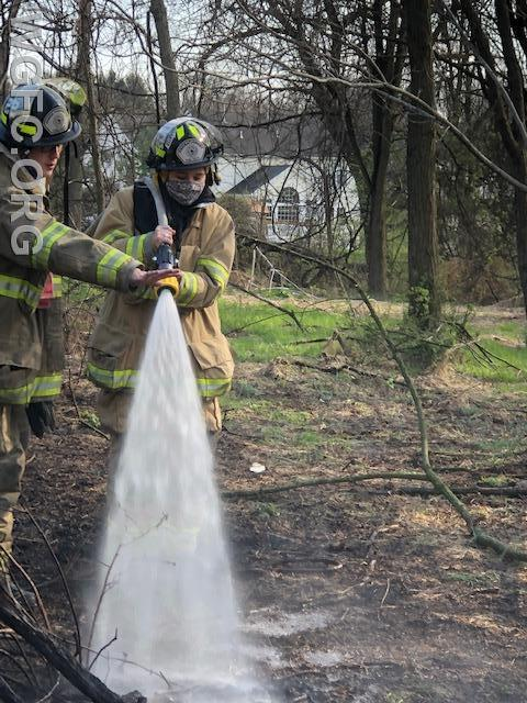 WGFC firefighters douse burning brush in Penn Township on Larchmont Lane.