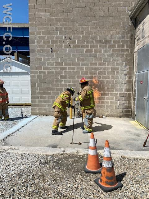 Hands on fire training as this WGFC member learns how to shut off a burning gas meter.