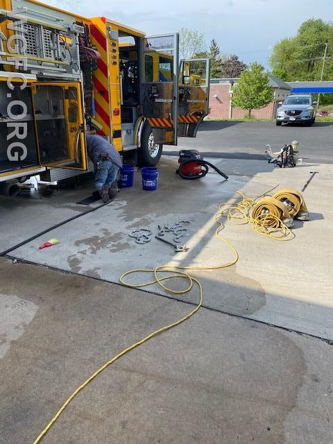 Cleaning a fire truck takes strong knees and elbow grease!