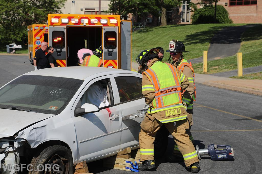 Firefighters work to pop a jammed door on the first car.