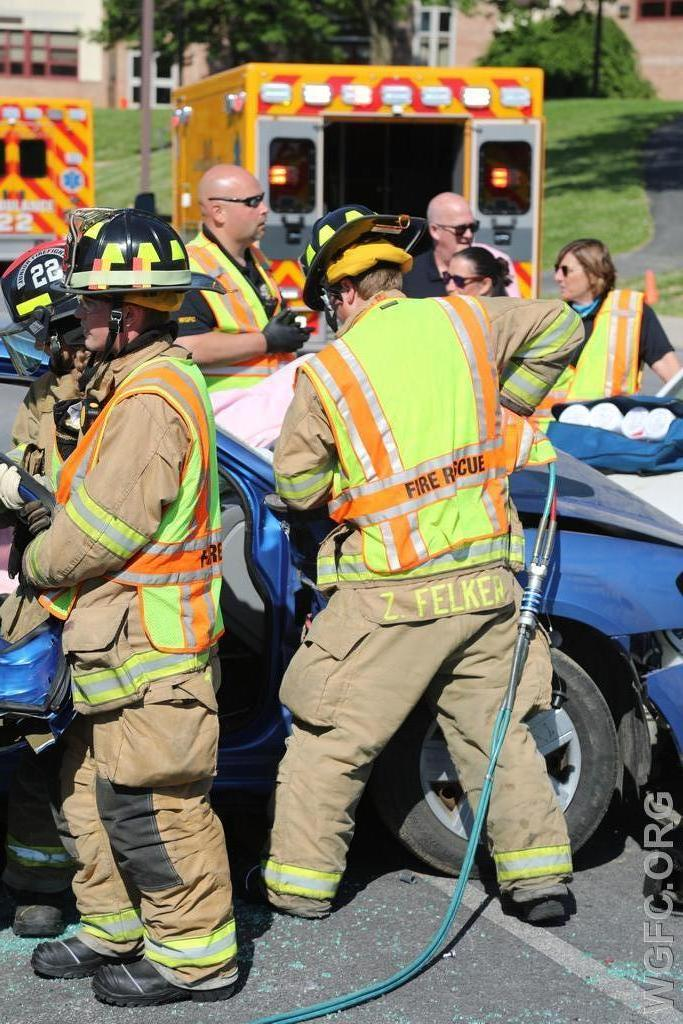 """Rescue tools often called the """"jaws of life"""" are used to remove doors on this damaged car."""