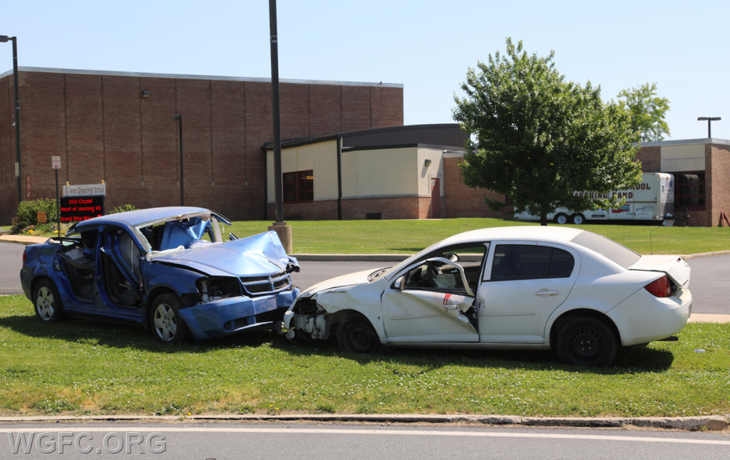 The wrecked cars were placed in front of the high school after the demonstration as a continuing reminder of the dangers of destructive decisions by student drivers.