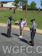 PA State Police perform a field sobriety test on one student driver.