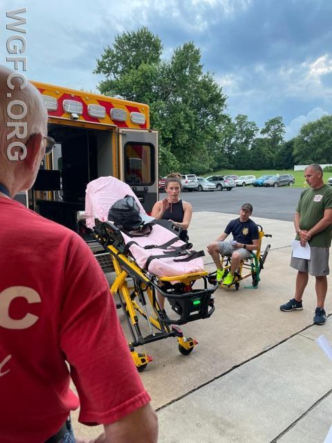 Firefighters get an overview of how to support the ambulance crew using stretchers and stair chairs.