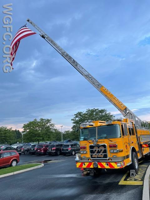 Ladder 22 proudly displays the fire company's large American flag at the AGIS at a back to school night.