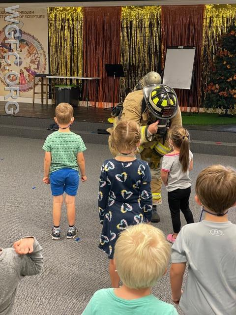 Students are encouraged to get up close to a real firefighter so they are not scared of them in a real emergency.