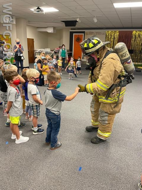 WGFC Firefighter Lisa shows students what  a fully-outfitted firefighter looks like as part of in-school Fire Prevention activities being held this month throughout the School District.