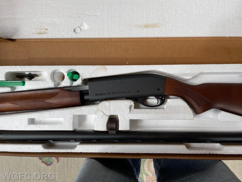 """This is a rare 2004 WGFC 100th Anniversary shotgun, that features a wood engraving of the Fire Company's Anniversary logo in the wood stock.  The shotgun is a new, in-the-original-box, Remington 870 Express, 12 gauge, with 28"""" barrel."""