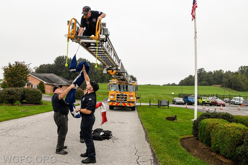 Members of WGFC's Ladder 22 crew prepare to fly the Fire Company's large American flag.