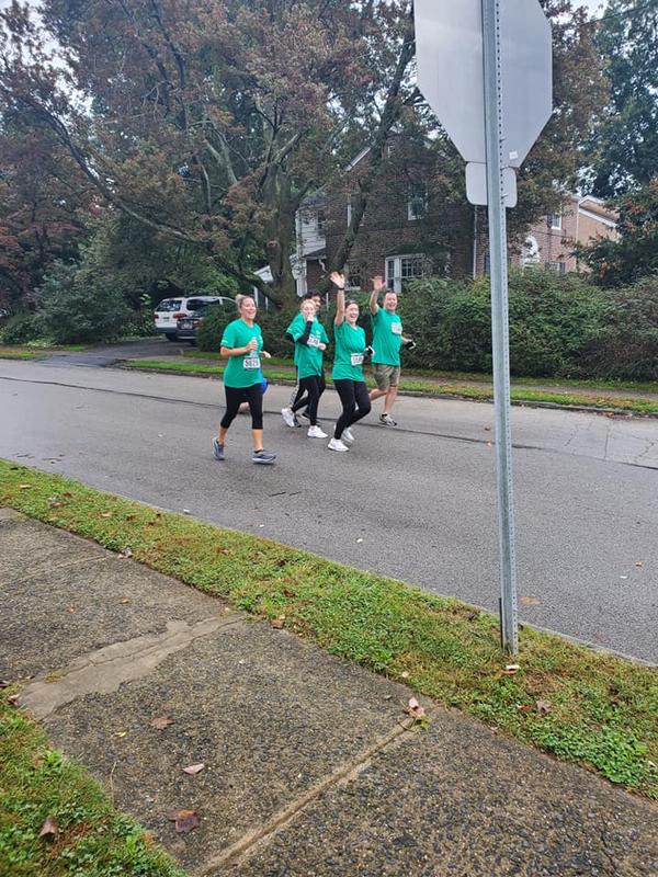 WGFC Captain Eric Felker runs with daughter Lindsay (waving).