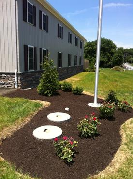 Local landscape company donates plants to new fire station for Local landscaping companies