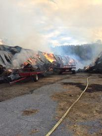 Two massive 50' x 500' barns surrounded by equally large piles of large hay bales were fully involved when units from nine fire companies arrived at the Fair Hill Nature Center in Cecil County, Maryland.