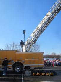 WGFC Mike Miller and ladder operator Mike Predmore Jr. watch the proceedings.