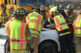 "West Grove Firefighters, along with the State Police and Medic 94, simulate a real car crash with multiple victims in a ""scared-straight"" program at the Avon Grove High School designed to highlight the dangers of distracted driving for student drivers in advance of prom season."