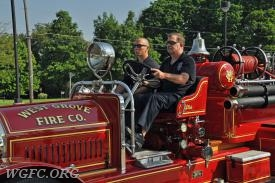 Chief Chambers and Firefighter Nash lead the West Grove fleet in the Avon Grove Memorial Day Parade.