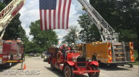 Former Assistant Chief Cliff Bennett takes his final ride to his resting place aboard Antique 22.   Chief John Chambers is driving, with Cliff's son Bob (former Chief of the Christiana Fire Company of Delaware) riding as his passenger.