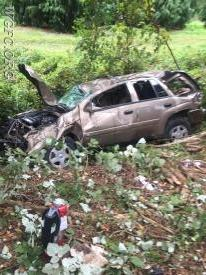 SUV at rest down embankment
