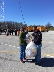 Firefighter Lisa Glass and Captain Andrew Vattilana send one of the packages of various egg containers to the top for the Egg Drop