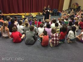 Fire Lisa talking with Penn London Elementary students about smoke detectors.