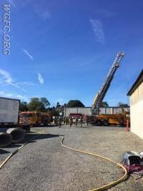 Ladder 22, CP and Engine 22-2 are positioned for the fire attack.