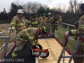 Training on rotary saw use on roof material.