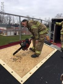 Instructor Pressler teaches proper chain saw operation on a roof evolution.  This portion of the class was on the WGFC training simulator located at the New London Station.