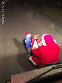 Mom and kids visit with Santa in front of Rescue 22.