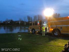 WGFC Engine 22-2 is set up at a pond to draft water to resupply tankers for the water shuttle operation.