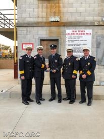 FF Tyler Simpson with his father past Chief and Current President Jeff Simpson along with the three Chiefs