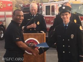 WGFC member and Chester County Fire Instructor Norman Fordes handing the completion certificate to FF Ahern
