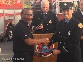WGFC member and Chester County Fire Instructor Norman Fordes handing the completion certificate to FF Oyler
