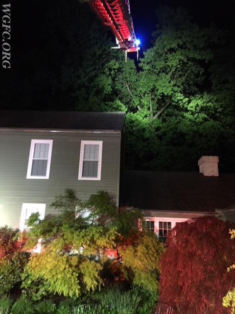 Ladder 22 illuminates the roof.