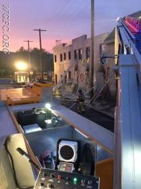 "This view from Ladder 22 shows the ""fire scene"" with hose lines and ladders deployed as night falls."